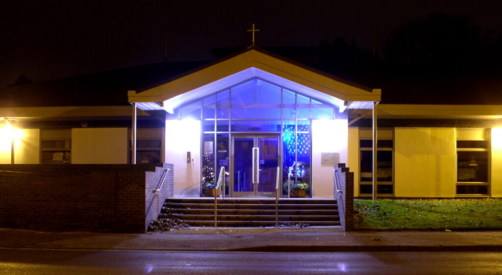 The front of the Christ Church building at Christmas at night